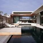 photo de maison en pierre avec piscine toit plat